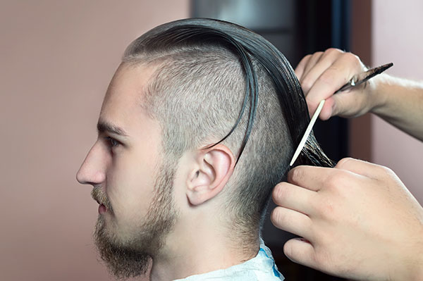 Image of a male having his hair cut