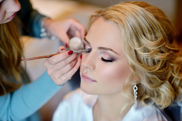 Image of a female having her makeup done