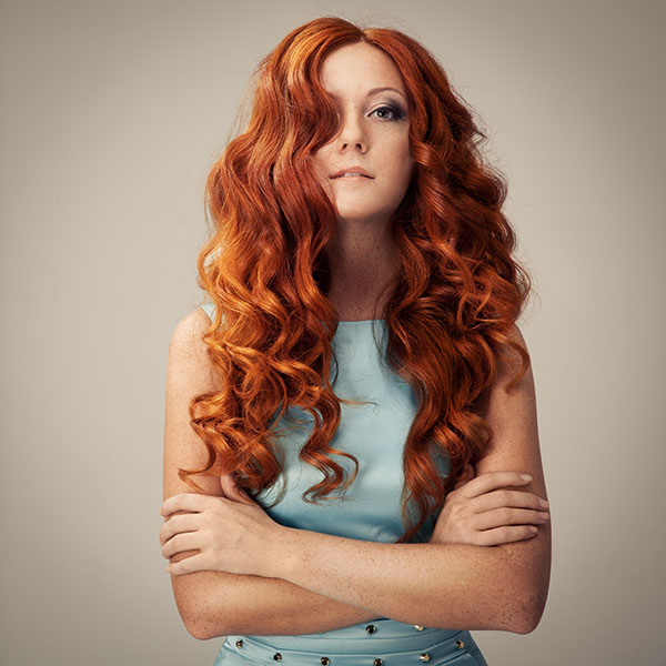 Image of a female with long wavy red hair