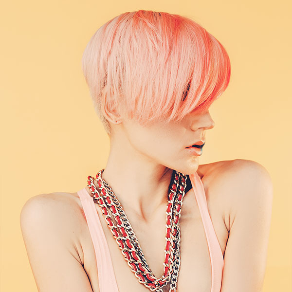 Image of a female with a short pixie cut dyed pink